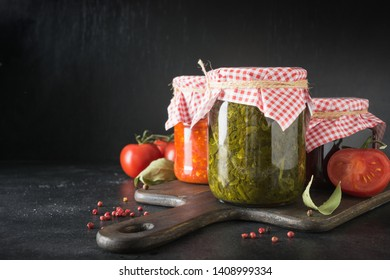 Various types of canned homemade sauce for serving to meat, adjika from tomato, sorrel, tkemali from plum. Homemade preparations, Homework and traditions.
