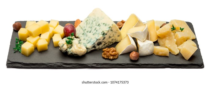 various types of cheese - brie, camembert, roquefort and cheddar on stone board