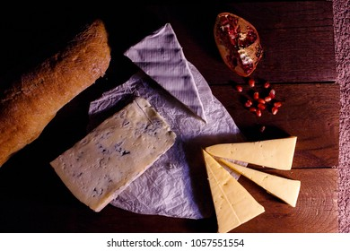 various types of cheese on rustic wooden table