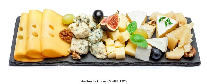 various types of cheese on stone board