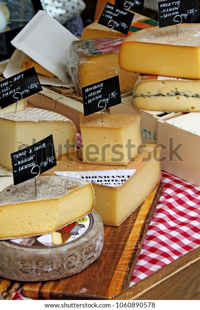 Various types of cheese on table. Cheese with label for sale at a market. Czech Republic.