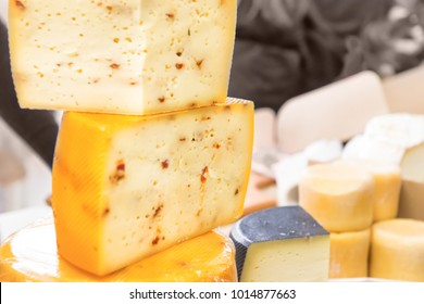 Various types of cheese on wooden desk