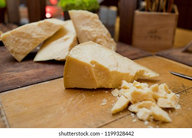 Various types of cheese on a wooden cutting board