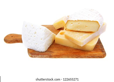 various types of cheese on wooden platter isolated on white background