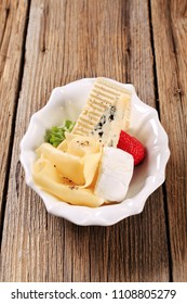 Various types of cheese in a serving bowl