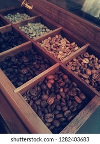 Various types of coffee in the box of wood