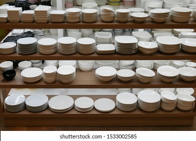 Various types of dishes on shelves