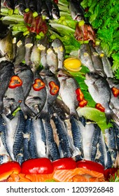 Various types of fish with red bell pepper,lemon, letucce in the market. .Mediterranean cuisine, healthy eating, healthy cooking concept