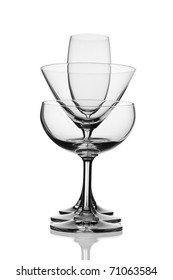 Various types of glasses on white background, champagne flute, champagne saucer, martini glass.