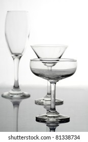 Various types of glasses on white background