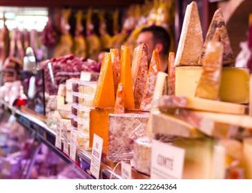 Various types of hard cheeses at Valencia Mercado de Colon historic Market in Valencia, Spain