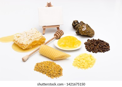Various types of honey and bee products on a white background