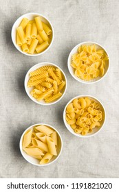 Various types of italian pasta in bowl. Top view.