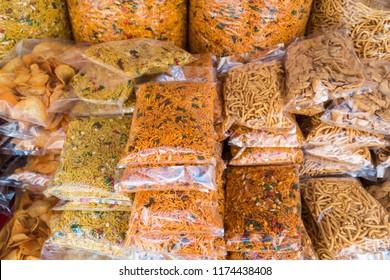 Various types of pakaged muruku at retail stall, popular Indian food in Malaysia