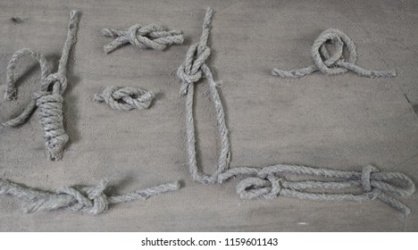 Various types of sailor knots on a blackboard