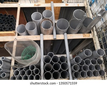 various types and sizes of pipes are arranged on shelves to facilitate work