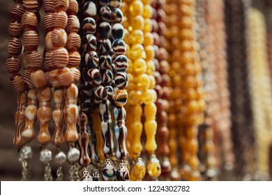 various types of tasbih displayed at a street vendor in Karbala, Iraq