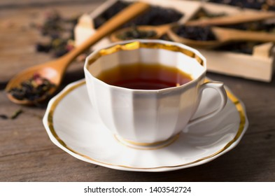 various types of tea on a wooden background