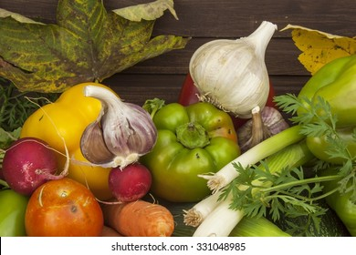 Various types of vegetables on an old wooden table. The concept of diet food. Food for obese patients. Autumn harvest vegetables.