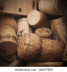 Various used wine corks in a wooden box