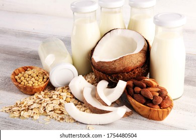 Various vegan plant based milk alternatives and ingredients. Dairy free milk substitute drink, healthy eating.