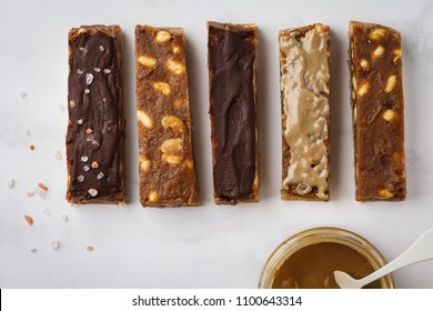 Various of vegan raw homemade nut candy bars. Healthy lifestyle and raw vegan food concept.