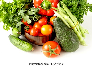 various vegetables (avocado, cucumbers, parsley, bell pepper, tomato)