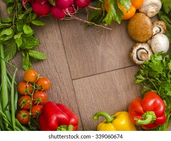 various vegetables in a circle on the floor
