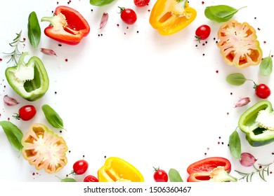 Various vegetables and herbs isolated on white background. Top view with copy space. Vegetarian and vegan food concept.