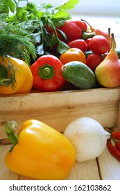 various vegetables in wooden crate, food raw