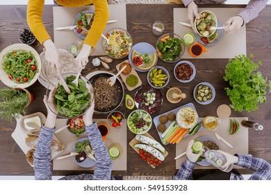 Various vegetarian food lying on rustic wooden table