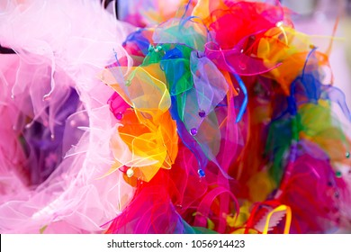 various vibrantly colored headpieces swirl together in a riot of mixed colour