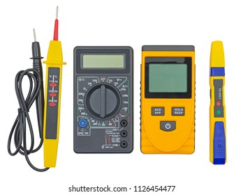 Various voltage tester and other electronic devices on white background
