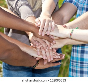 Various young persons showing symbol of loyalty.