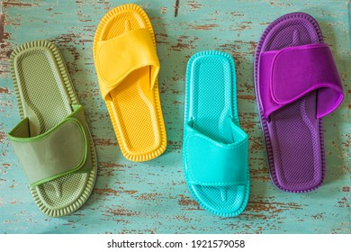 Variously colored flip-flops for walking on the house or the beach. Stylish Design of different sizes, Background