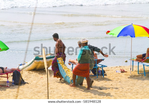 VARKALA, INDIA - JAN 05, 2017: Unidentified Indian Fishermen on beach in Varkala. Kerala. India