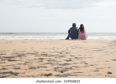 VARKALA, INDIA - SEPTEMBER 03: Couples/tourists/friends enjoying/sitting on the beach watching waves in Gods own country on September 03, 2016 on Varkala beach/seashore, in Trivandrum, Kerala,India