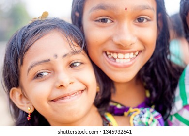 VARKALA, KERALA, INDIA - DECEMBER 15, 2012:  Portrait smiling indian children on Varkala during puja ceremony on holy place - on the Papanasam beach