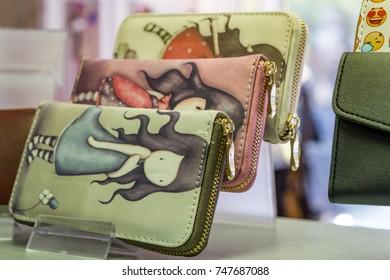 Varna, Bulgaria - 20/10/2017. Santoro Gorjuss, close-up of leather purses, souvenirs in shop.