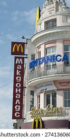 VARNA, BULGARIA - April 09, 2015: McDonald's restaurant and Britannica learning office logis in the downtown of the sea capitol of Bulgaria. They are located in ancient architectural building.