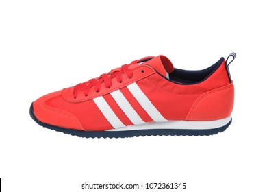 Varna , Bulgaria - APRIL  15, 2018 : ADIDAS VS JOG sport shoe. Product shot. Adidas is a German corporation that designs and manufactures sports shoes, clothing and accessories