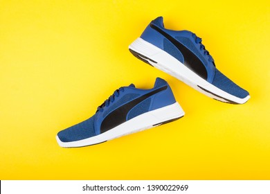 Varna , Bulgaria - APRIL 24, 2019: PUMA ST TRAINER EVO KNIT sport shoes on yellow background. Puma is a German company. PUMA is the third largest sportswear manufacturer in the world. Product shot