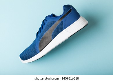 Varna , Bulgaria - APRIL 24, 2019 PUMA ST TRAINER EVO KNIT sport shoe on blue background. Puma is a German company. PUMA is the third largest sportswear manufacturer in the world. Product shots