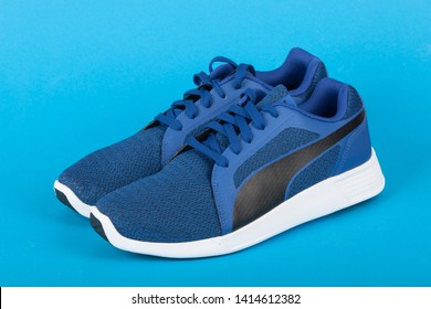 Varna , Bulgaria - APRIL 24, 2019: PUMA ST TRAINER EVO KNIT sport shoes on blue background. Puma is a German company. PUMA is the third largest sportswear manufacturer in the world. Product shot