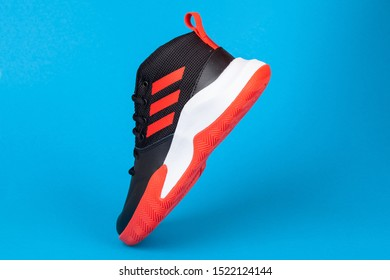 Varna , Bulgaria - AUGUST 13, 2019 : ADIDAS sport shoe, on blue background. Product shot. Adidas is a German corporation that designs and manufactures sports shoes, clothing and accessories
