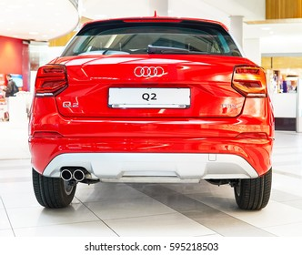 Varna, Bulgaria - Circa January  2017: New red Audi Q2. Front close-up. Showroom Grand Mall