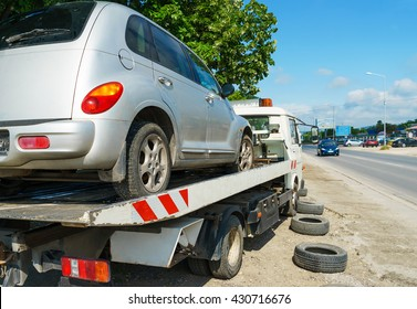 Varna, Bulgaria - Circa May 2016: Tow truck carrying the defective car. Sedan car after road accident