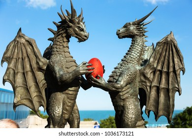 """Varna, Bulgaria - CIRKA 2017: a detail from the modern statue """"Dragons in Love"""" by artist Darin Lazarov, located in the Sea Garden of Varna. Famous ancient bronze monument to the dragon"""