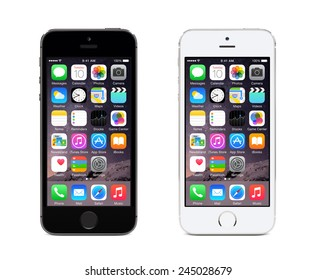 Varna, Bulgaria - December 08, 2013: Apple Space Gray and Silver iPhone 5S displaying iOS 8, mobile operating system, designed by Apple Inc. Isolated on white background.