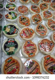 Varna, Bulgaria, December 18, 2017 - Bulgarian white and yellow cheeses Kashkaval in cellophane packages in the duty free shop of Varna airport.